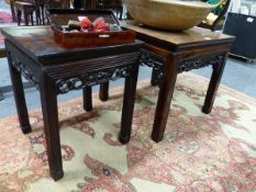 TWO CHINESE CARVED HARDWOOD SQUARE STANDS WITH PIERCED FOLIATE APRONS AND MOULDED STRAIGHT LEGS.