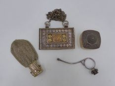 AN EASTERN WHITE METAL GHAO BOX TOGETHER WITH AN OPIUM FINGER PIPE, A SILVER TRINKET BOX AND A