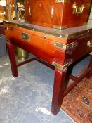 A BRASS BOUND MAHOGANY SQUARE CAMPAIGN STYLE BIJOUTERIE TABLE WITH GLAZED TOP AND BRASS CARRYING