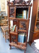 A GOOD CHINESE CARVED HARDWOOD DISPLAY CABINET WITH OVERALL FOLIATE AND BIRD DECORATION WITH PIERCED