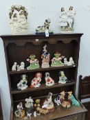 A GROUP OF POTTERY ANIMAL FIGURES AND SPILL VASES TO INCLUDE STAFFORDSHIRE GROUPS, SYLVAC, ROYAL