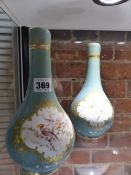 A PAIR OF VICTORIAN BOTTLE FORM COVERED VASES DECORATED WITH BIRDS AND GILDING IN THE FRENCH MANNER.