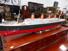 A SCRATCH BUILT MODEL OF R.M.S. TITANIC ON A STAND. L.136cms.