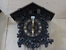 AN EARLY 20th.C.CARVED BLACK FOREST TYPE WALL CUCKOO CLOCK.