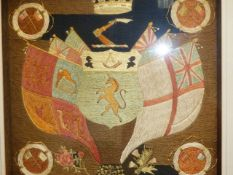 AN ANTIQUE SILKWORK PANEL OF AN ARMORIAL CREST SURROUNDED BY FLAGS IN BESPOKE SHADOW BOX FRAME. 42 x