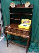A CHINESE CARVED HARDWOOD SIDE TABLE, SHELF SUPERSTRUCTURE ABOVE TWO APRON DRAWERS. H.142 W.76cms.