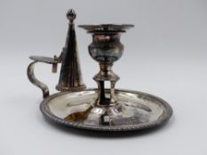 A SILVER HALLMARKED CHAMBERSTICK HAVING A ROUND BASE WITH A GADROON BORDER, A HANDLE WITH THUMB