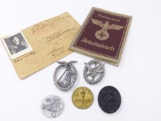 A COLLECTION OF FIVE GERMAN MILITARY BADGES TOGETHER WITH A NAZI STAMPED BORDER PASS(?) AND A