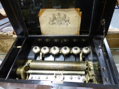 "A 19th.C.LEVER WIND MUSICAL BOX PLAYING SIX AIRS OVER, 11"" CYLINDER AND SIX BELLS IN ROSEWOOD AND"