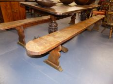 A PAIR OF EARLY 19th.C.FRUITWOOD FORMS ON TRESTLE ENDS. L.309 x W.22cms.