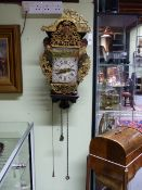 AN ANTIQUE DUTCH STAART WALL CLOCK WITH ORIGINAL PAINTED BRACKET AND PIERCED CAST METAL MOUNTS.
