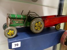 AN ENGLISH TINPLATE TOY TRACTOR AND TRAILER MARKED MADE IN GT.BRITAIN.