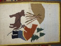 A VINTAGE GRENFELL LABRADOR INDUSTRIES WOOLWORK MAT DEPICTING AN INNUIT FIGURE WITH A DOG, COMPANY