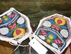 A NER PAIR OF NORTH AMERICAN WOODLAND INDIAN BEADWORK PURSES EACH WITH FLORAL DESIGNS ON BLACK