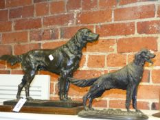 THREE ANIMALIER TYPE FIGURES OF DOGS, TWO SETTERS AND A TERRIER AND AN IRON FORM DOG NUTCRACKER.