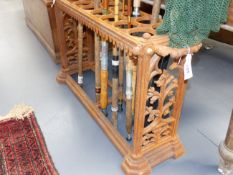 A CAST IRON COALBROOKDALE TYPE TWIN HANDLED STICKSTAND IN THE GOTHIC STYLE. W.96cms.