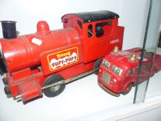 A TRI-ANG PUFF-PUFF TRAIN AND A WEST GERMAN TINPLATE FIRE ENGINE.