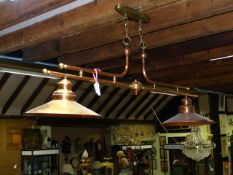 A POLISHED COPPER AND BRASS BILLIARD ROOM HANGING DOUBLE LIGHT FITTING SIGNED PIERRE VERGNES