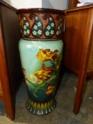 A VICTORIAN POTTERY UMBRELLA/STICK STAND. DECORATED WITH BIRDS AND FLOWERS. H.66cm.