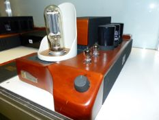 A RARE MATCHED PAIR OF UNISON SMART 845 VALVE AMPLIFIERS TOGETHER WITH A MUSICAL FIDELITY E20