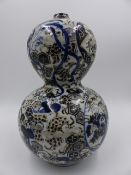 A JAPANESE GOURD FORM VASE WITH UNUSUAL FOLIATE AND GEOMETRIC DECORATION. H.26cms.