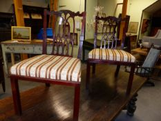 A PAIR OF GEORGIAN CARVED MAHOGANY CHAIRS WITH PIERCED GOTHIC STYLE SPLATS BELOW SHAPED CREST
