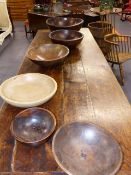 A GROUP OF SIX 18th AND 19th.C. TURNED ELM AND SYCAMORE KITCHEN BOWLS. LARGEST D.50cms