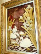 AN UNUSUAL LARGE VINTAGE PILED WOOLWORK PICTURE OF SWANS IN MOULDED GILT FRAME. 66 x 43cms.