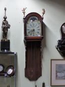 A DUTCH STAART WALL CLOCK WITH PAINTED ARCH DIAL AND HOOD SURMOUNTED WITH GILT FIGURES. COMPLETE