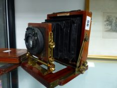 A VINTAGE QUARTER PLATE MAHOGANY CAMERA THE YNSTANTOGRAPH PATENT WITH CHRONOS LENS.