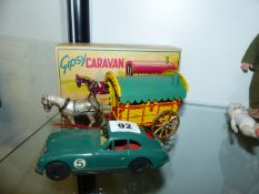 A MORESTONE DIE CAST GYPSY CARAVAN COMPLETE WITH CARD BOX, HORSE AND DRIVER TOGETHER WITH A TINPLATE