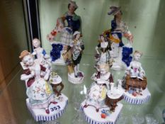 FOUR CONTINENTAL PORCELAIN POLYCHROME FIGURES REPRESENTING THE SEASONS TOGETHER WITH ANOTHER
