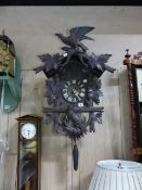 AN EARLY 20th.C.BLACK FOREST CARVED CASE CUCKOO WALL CLOCK. H.70 x W.50cms.