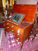 A WELL APPOINTED GENTLEMAN'S REGENCY DRESSING TABLE WITH LIFT TOP ENCLOSING A FITTED INTERIOR