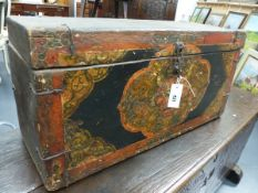 AN ORIENTAL POLYCHROME DECORATED AND IRON MOUNTED TRUNK, THE FRONT WITH A DRAGON MASK FRAMED BY