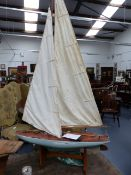 AN EARLY 20th.C.POND YACHT WITH FIBREGLASS HULL AND TWO SETS OF SAILS,ETC. L.93cms.