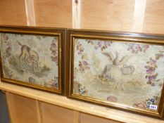 TWO ANTIQUE FRENCH SILK AND WOOLWORK TAPESTRY PANELS OF ANIMALS IN FLORAL SURROUNDS. 32 x 44cms.
