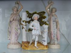 A PAIR OF BISQUE PORCELAIN FIGURINES N THE CLASSICAL STYLE AND A VICTORIAN VASE.