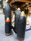 A GROUP OF FOUR HEAVY ARTILLERY PROJECTILES, EACH TIMED FUSE NOSE COVERS, LARGEST H.60 x D.14cms.
