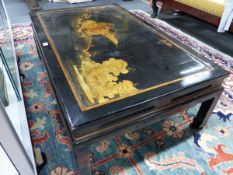 A CHINESE CHINOISERIE LACQUER PANEL MOUNTED AS A LOW TABLE. H.36 W.113 D.70cms.