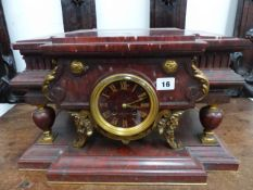 A VICTORIAN ROUGE MARBLE AND GILT BRONZE MOUNTED MANTLE CLOCK, THE DIAL INSCRIBED BARBEDIENNE,