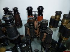 A COLLECTION OF TWELVE PAIRS OF BINOCULARS, FIELD GLASSES AND OPERA GLASSES. (12)
