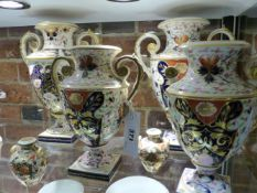 SIX EARLY 19th.C.URN FORM TWIN HANDLED VASES DECORATED IN THE IMARI PALETTE WITH GILT ACCENTS,