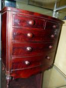 A VICTORIAN MINIATURE MAHOGANY BOW FRONT APPRENTICE CHEST, TWO SHORT DRAWERS OVER THREE LONG DRAWERS