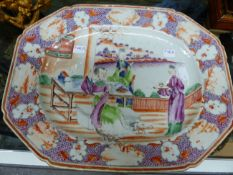 A CHINESE EXPORT FAMILLE ROSE OCTAGONAL MEAT PLATE, CENTRAL SCENE OF FIGURES ON A TERRACE. W.36.