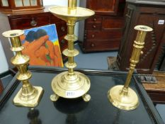 THREE ANTIQUE BRASS CANDLESTICKS AND A QUANTITY OF PEWTER PLATES.