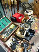 A LARGE COLLECTION OF VINTAGE FISHING RODS, SPINNING REELS AND FLOATS TOGETHER WITH AN EARLY 20th.
