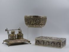 A WHITE METAL INDIAN EMBOSSED CIGARETTE BOX AND BOWL TOGETHER WITH A TWO BOTTLE INKSTAND.