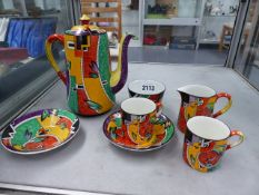 A RARE ART DECO COFFEE SET IN JAZZ PATTERN.