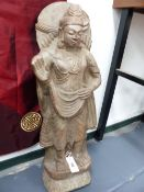AN IMPRESSIVE INDIAN CARVED STONE FIGURE OF A STANDING DEITY. H.78cms.